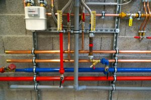 wall of multi-colored pipes for plumbing