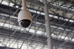 circular wireless camera hanging from ceiling