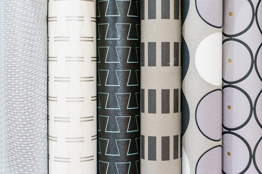 Six different wallpaper rolls with different prints